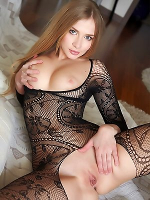 Raffaella showcases her seductive allure and smoking hot body as she poses eroticaly in   the livingroom.
